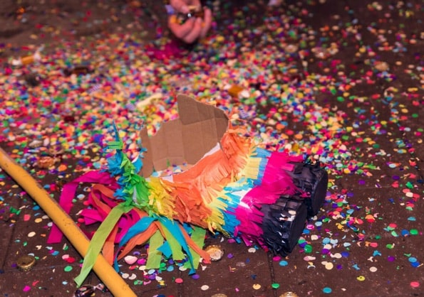 Pinata smashed with bright coloured confetti